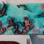 A 15 foot long by 5 foot high mural aquarium with papier mache fish and other assorted marine life. ©1998 Kristen Muench photo by Debra Whalen