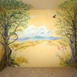 Two lovely character trees with birds and small creatures form an Arbor Mural over this girl's headboard and surrounding wall areas. Private Home,  ©2006 Kristen Muench photo by KM