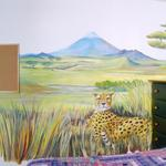 This cheetah's eyes follow you around the room as he relaxes is a space enhancing African Grasslands mural.  ©2001 Kristen Muench photo by David A. Harvey