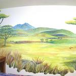 A very small, dark bedroom is transformed into an expansive panorama of the African grasslands complete with Mt. Kilimanjaro and some favorite animals. This mural creates the impression of vast space and a larger world where the imagination may travel.  ©2001 Kristen Muench photo by David A. Harvey