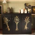 Freehand painting of wheat bundles on a black cabinet. 7/2012 © Kristen Muench