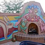 Mimbres style animals painted on outdoor fireplace and patio area. Marana, AZ ©2012 Kristen Muench